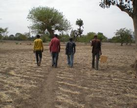 Source - Blake Zachary, The DHS Program/ICF International. Description - Field workers walking to a cluster in Ethiopia.